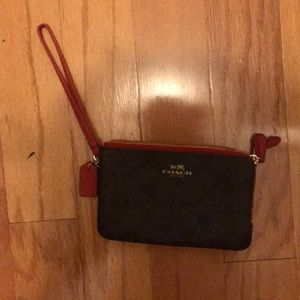 Never been used - Coach Wristlet!
